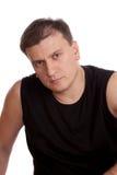 Der Mann in einem schwarzen T-Shirt Lizenzfreie Stockfotos