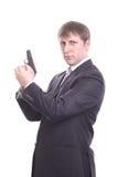 Der Mann in einer Klage mit einer Pistole Stockfotos