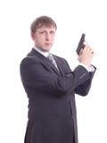 Der Mann in einer Klage mit einer Pistole Lizenzfreies Stockbild