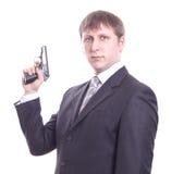 Der Mann in einer Klage mit einer Pistole Stockbilder