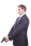 Der Mann in einer Klage mit einer Pistole Lizenzfreies Stockfoto