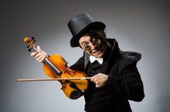 Der Mann im musikalischen Kunstkonzept Stockfotografie