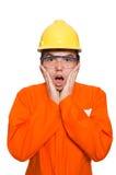 Der Mann im orange Overall lokalisiert auf Weiß Stockfotografie