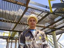 Der Mann im Overall von Rosneft Rechtsform einer Unternehmung in Rosneft Stockbild