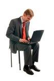 Der Mann mit dem Computer stockbilder