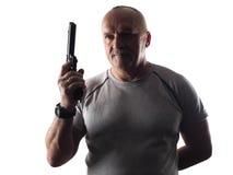 Der Mann mit dem Gewehr Stockfotos