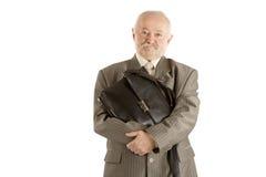 Der Mann mit einem schwarzen ledernen Kasten Lizenzfreies Stockbild