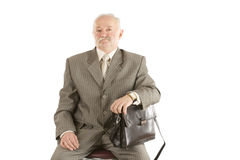 Der Mann mit einem schwarzen ledernen Kasten Lizenzfreies Stockfoto