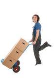 Der Mann springend mit Hand-LKW und -kästen Stockfoto