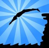 Der Mann springend von der Klippe Lizenzfreie Stockfotos