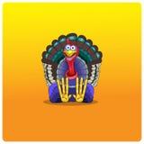 Der mehrfarbige Truthahnhahn sitzt und wartet auf Danksagungs-Tag Stockfoto