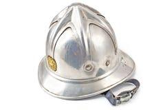 Der metallische Sturzhelm des alten Feuerwehrmannes Lizenzfreie Stockfotografie