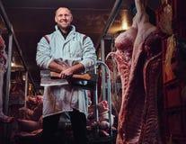 Der Metzger in einer Fleischfabrik Stockfotografie