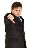 Der mißfallene Geschäftsmann, der Daumen gestikulieren zeigt unten Stockfotografie