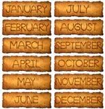 Der Monat in der Weinleseart auf gealtertem, altem Papier Lizenzfreies Stockbild