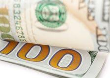 Der neue Dollarschein US 100 auf Weiß Lizenzfreies Stockbild