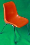 Der orange Stuhl Stockfotografie