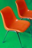 Der orange Stuhl Stockbild
