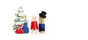 Der Parteieinladungs-Karte des neuen Jahres Retro- Design Abstrakte Wäscheklammerhelden altmodischer Mann und Frau und Weihnachts Lizenzfreies Stockbild
