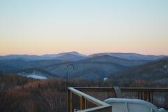 Der Pastellsonnenuntergang angesehen von der Plattform Lizenzfreie Stockfotografie