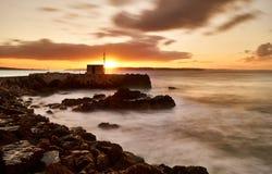 Der Pier bei Sonnenaufgang Stockfotos