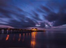 Der Pier bei Sonnenuntergang Lizenzfreie Stockbilder