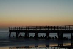 Der Pier nachts Stockfoto
