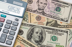 Der Rechner und US-Dollars Stockbilder