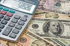 Der Rechner und US-Dollars Stockfotos