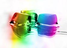 Der Regenbogen über schmelzendem Eis Stockfotos