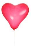 Der rote Ball in Form von dem Herzen an lokalisiert Lizenzfreie Stockfotos