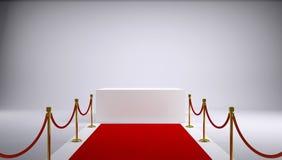 Der rote Teppich und der weiße Kasten. Grauer Hintergrund Stockfotos