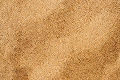 Der Sand durch den Strand Lizenzfreies Stockbild