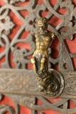 Der Satyr auf der Tür Stockbilder