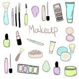 Der Satz der Hand gezeichnet kritzelt mit Make-upeinzelteilen Stockfoto