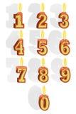 Der Satz von Zahlen in Form von brennenden Kerzen Lizenzfreie Stockfotos