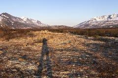 Der Schatten des Fotografen in der alpinen Tundra Stockfotos