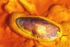 Der Schlamm, der von den Bergwerken von Rio Tinto, Huelva, Spanien kommt Stockfoto