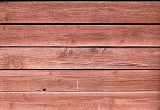 Der Schmutz, welche Rot gemalter Eiche abzieht, verschalt Hintergrund Lizenzfreie Stockfotografie