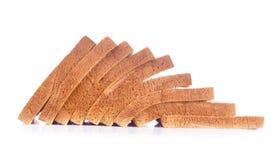 Der Schnitt-Brotlaib auf Weiß Lizenzfreies Stockfoto