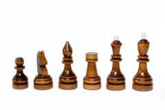 Der Schuss des schwarzen Schachspiels des Holzes auf dem weißen Hintergrund Stockbilder