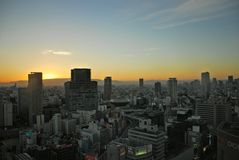 Der Sonnenaufgang von Osaka-Stadtbild Stockfotos