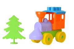 Der Spielzeugzug vom Designer auf einem Weiß lokalisierte Hintergrund Stockfotos