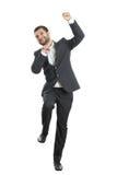 Der springende und Geschäftsmann, lachende Stockfoto