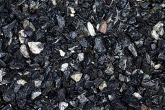Der Stein, der für Bau, nasser blauer dunkler Steinhintergrund naß ist, schaukelt nasses Wasser für Bauarbeit lizenzfreie stockbilder