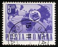 Der Stempel, der in Rumänien gedruckt wird, zeigt Telexinstrument und -Weltkarte Lizenzfreies Stockbild