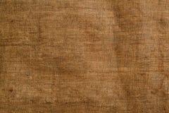 Der Stoff, das alte epische Gewebe, das Gewebe, die Textilmaterialnahaufnahme lizenzfreie stockfotografie