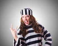 Der Strafgefangeneverbrecher in gestreifter Uniform Lizenzfreies Stockfoto