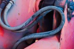 Der Teil des Hydrauliksystems mit Schläuchen ist nah stockbilder
