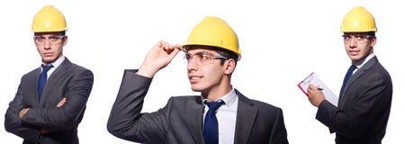 Der tragende Schutzhelm des Mannes lokalisiert auf Weiß Lizenzfreie Stockbilder